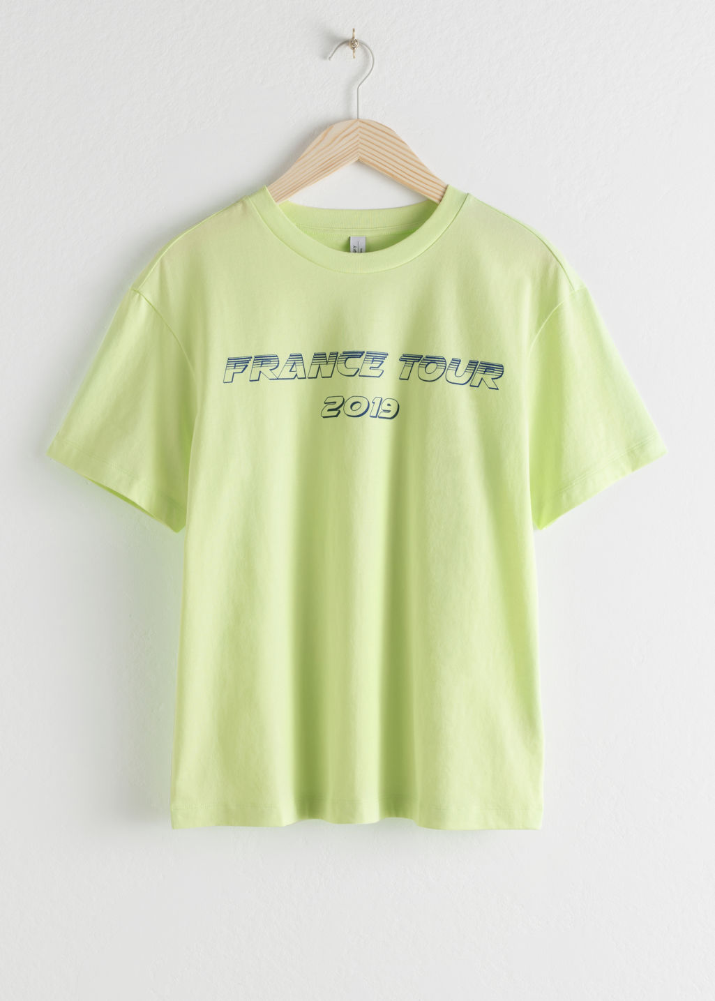 Front image of Stories france tour 2019 tee in yellow