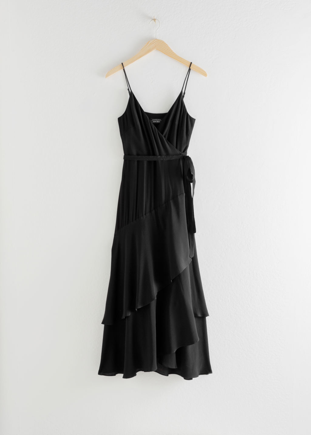 Front image of Stories ruffled midi wrap dress in black