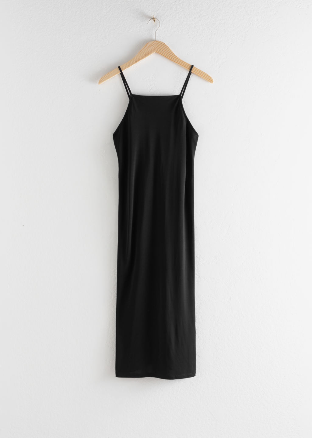 Front image of Stories square neck midi slip dress in black