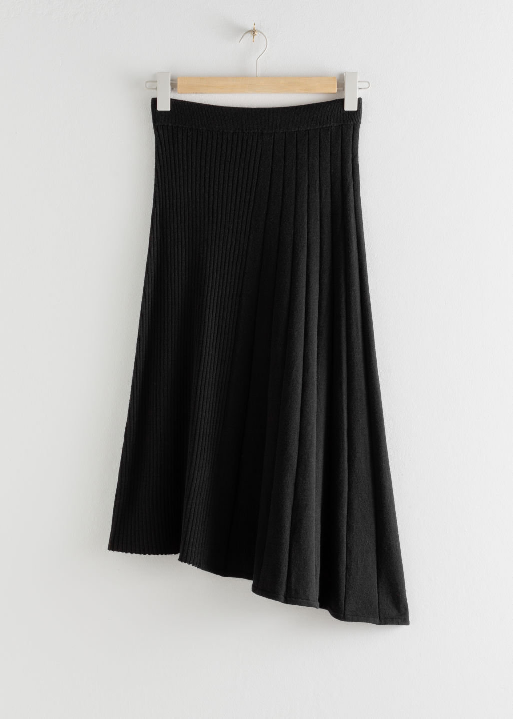 Front image of Stories asymmetrical pleated knit midi skirt in black