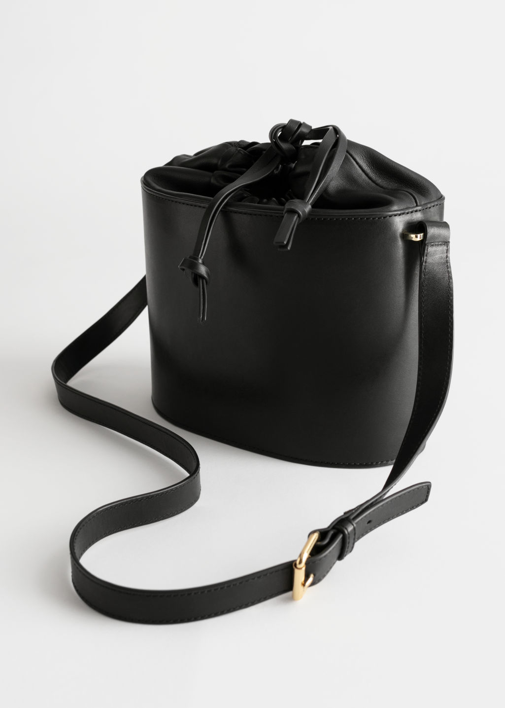 Back image of Stories small leather bucket bag in black