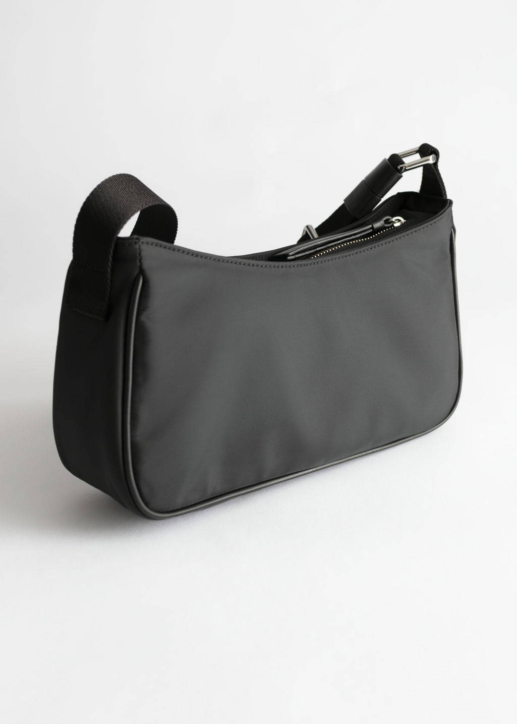 Front image of Stories nylon baguette bag in black
