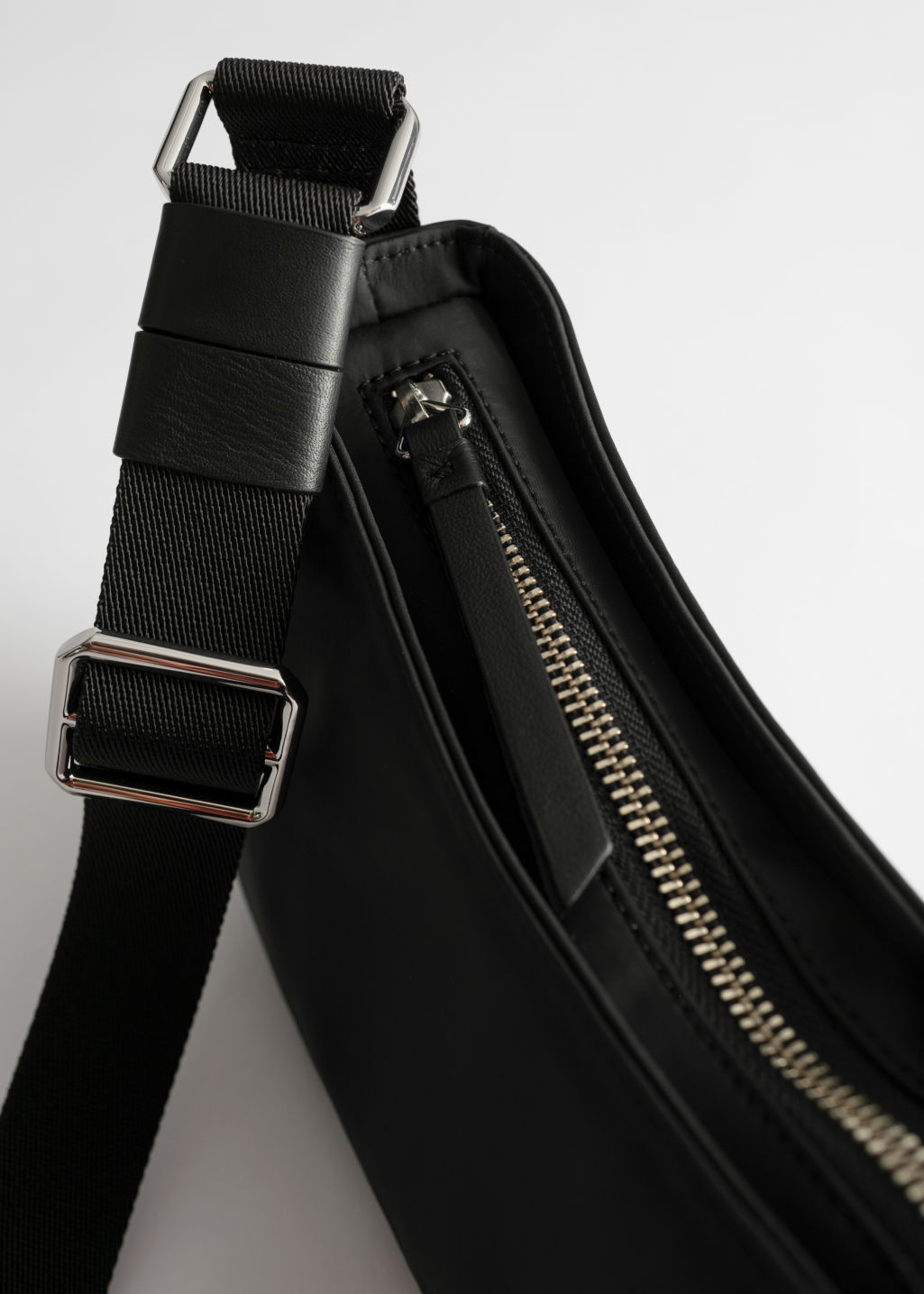 Back image of Stories nylon baguette bag in black