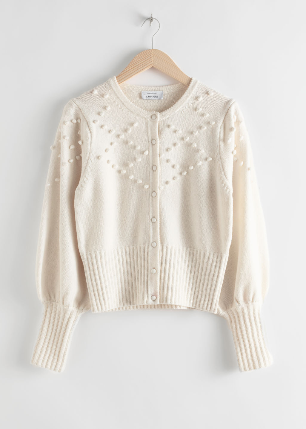 Front image of Stories bobble pattern wool blend cardigan in white