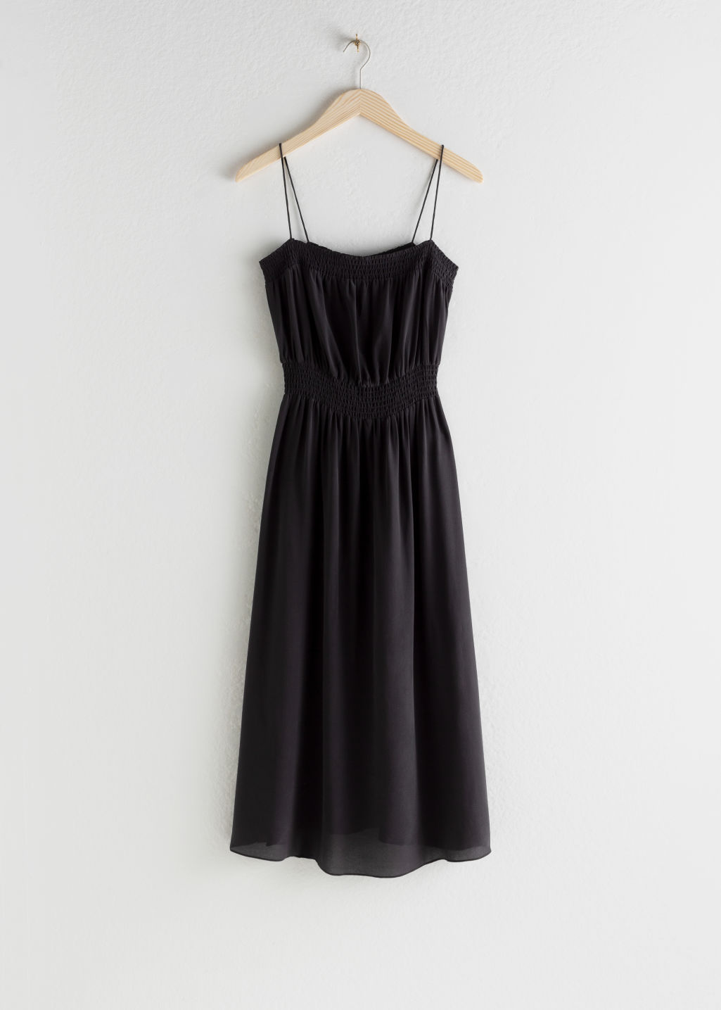 StillLife Front Image of Stories Smocked Silk Midi Dress in Black