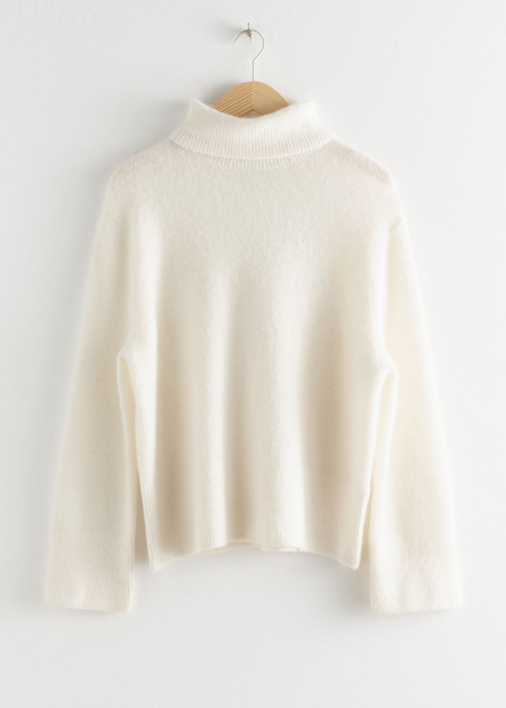 Front image of Stories alpaca blend turtleneck sweater in white