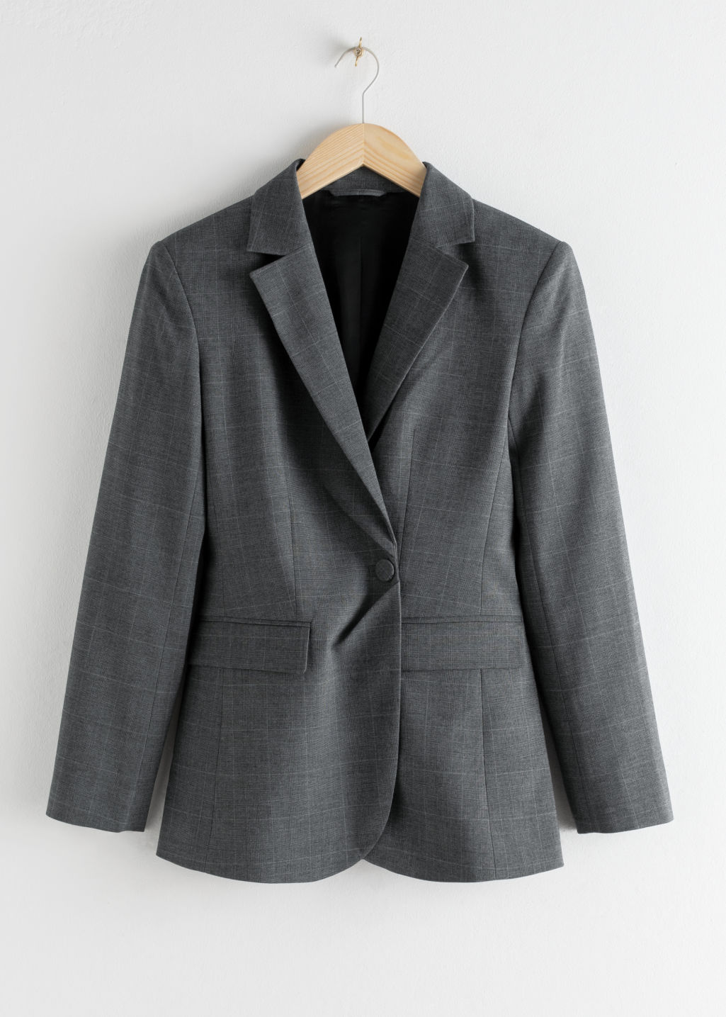 Front image of Stories asymmetric single button plaid blazer in grey