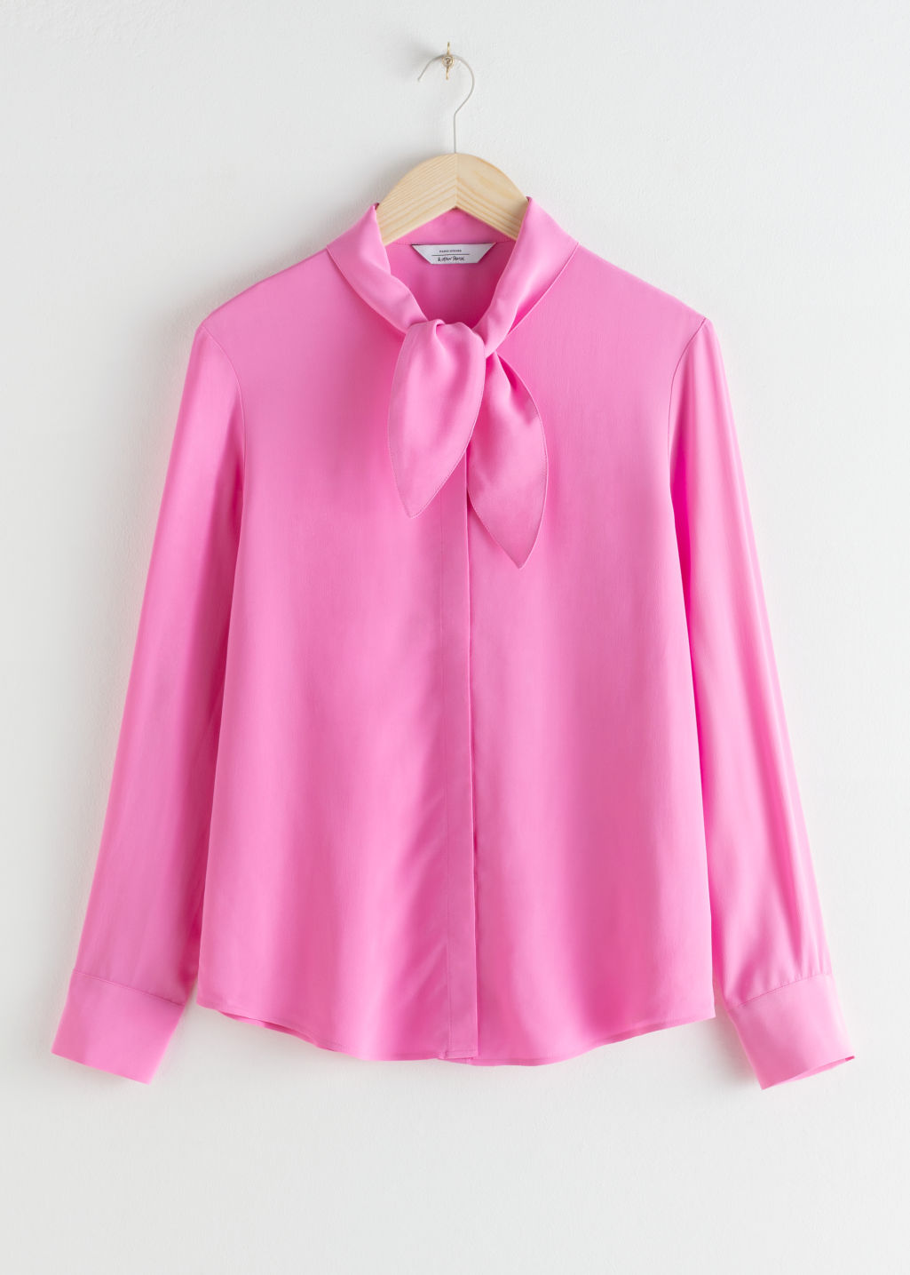Front image of Stories satin pussy bow blouse in pink