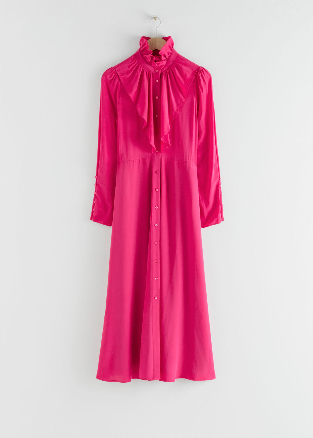 Front image of Stories ruffled button up midi dress in pink