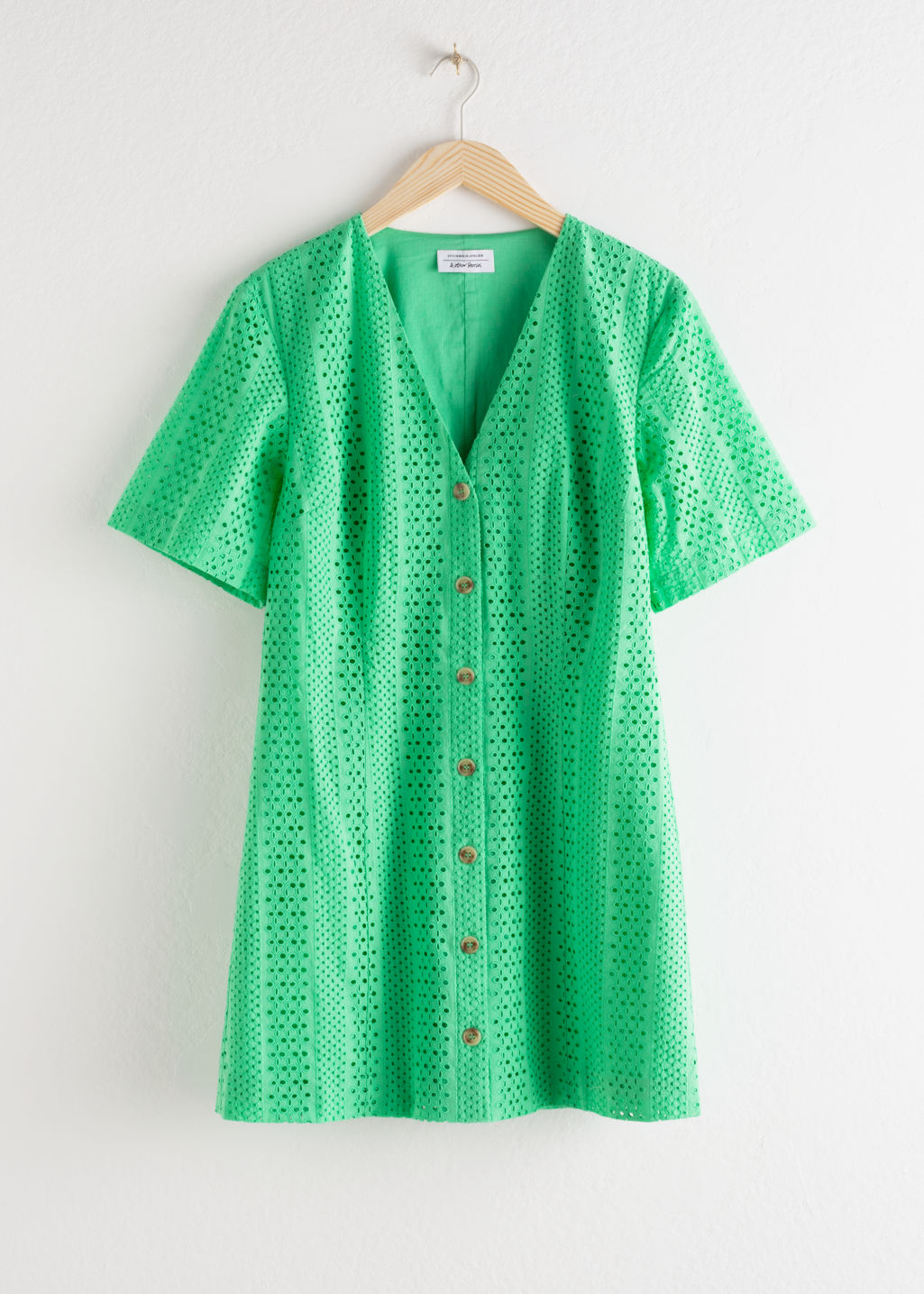 Front image of Stories cotton dobby button up mini dress in green