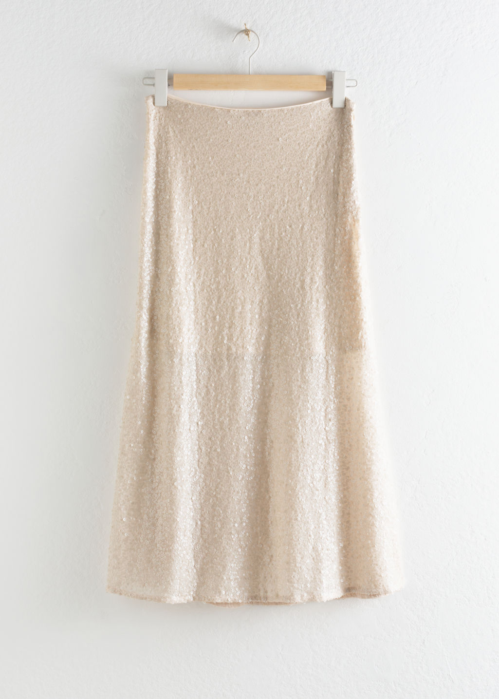 Front image of Stories sequin embellished midi skirt in beige