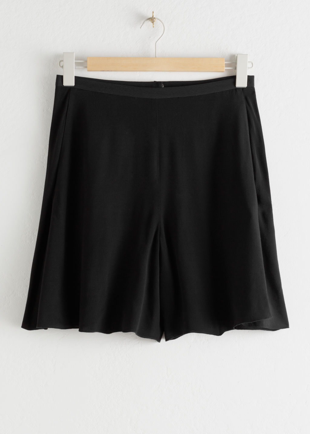 StillLife Front Image of Stories High Waisted Relaxed Crepe Shorts in Black