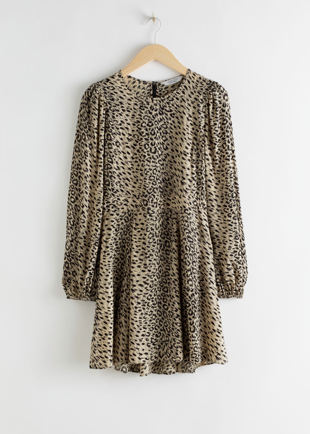 StillLife Front Image of Stories Flowy Leopard Print Mini Dress in Beige