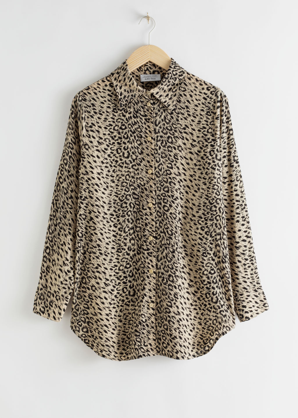 Front image of Stories flowy button up shirt in beige