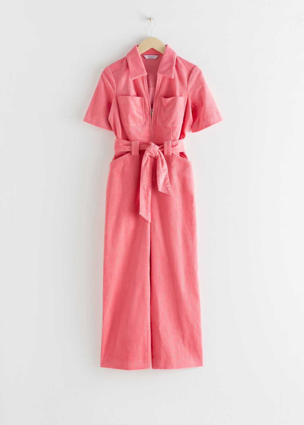 Front image of Stories corduroy knot belt jumpsuit in pink