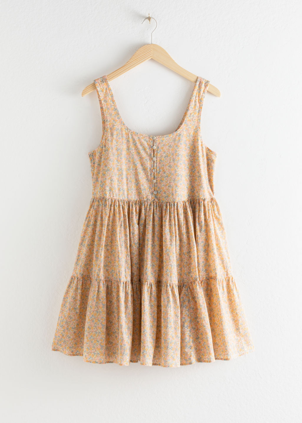 Front image of Stories tiered ruffled mini dress in beige