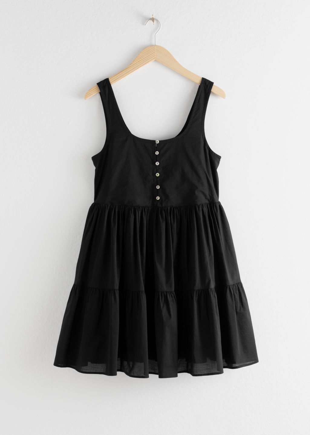 Front image of Stories tiered ruffled mini dress in black