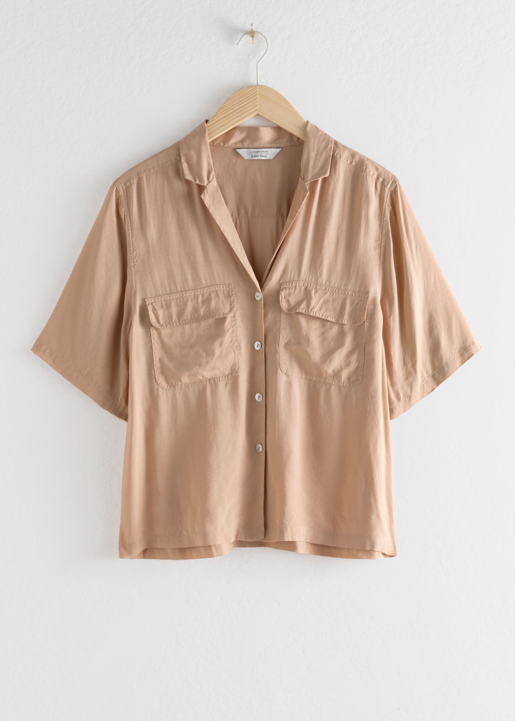 Front image of Stories satin workwear button up shirt in beige