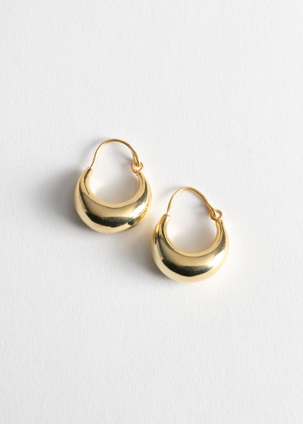 StillLife Front Image of Stories Droplet Hoop Earrings in Gold