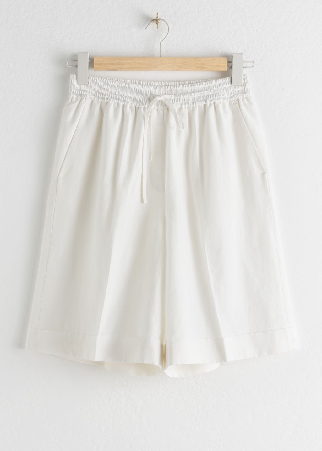 Front image of Stories drawstring linen blend shorts in white