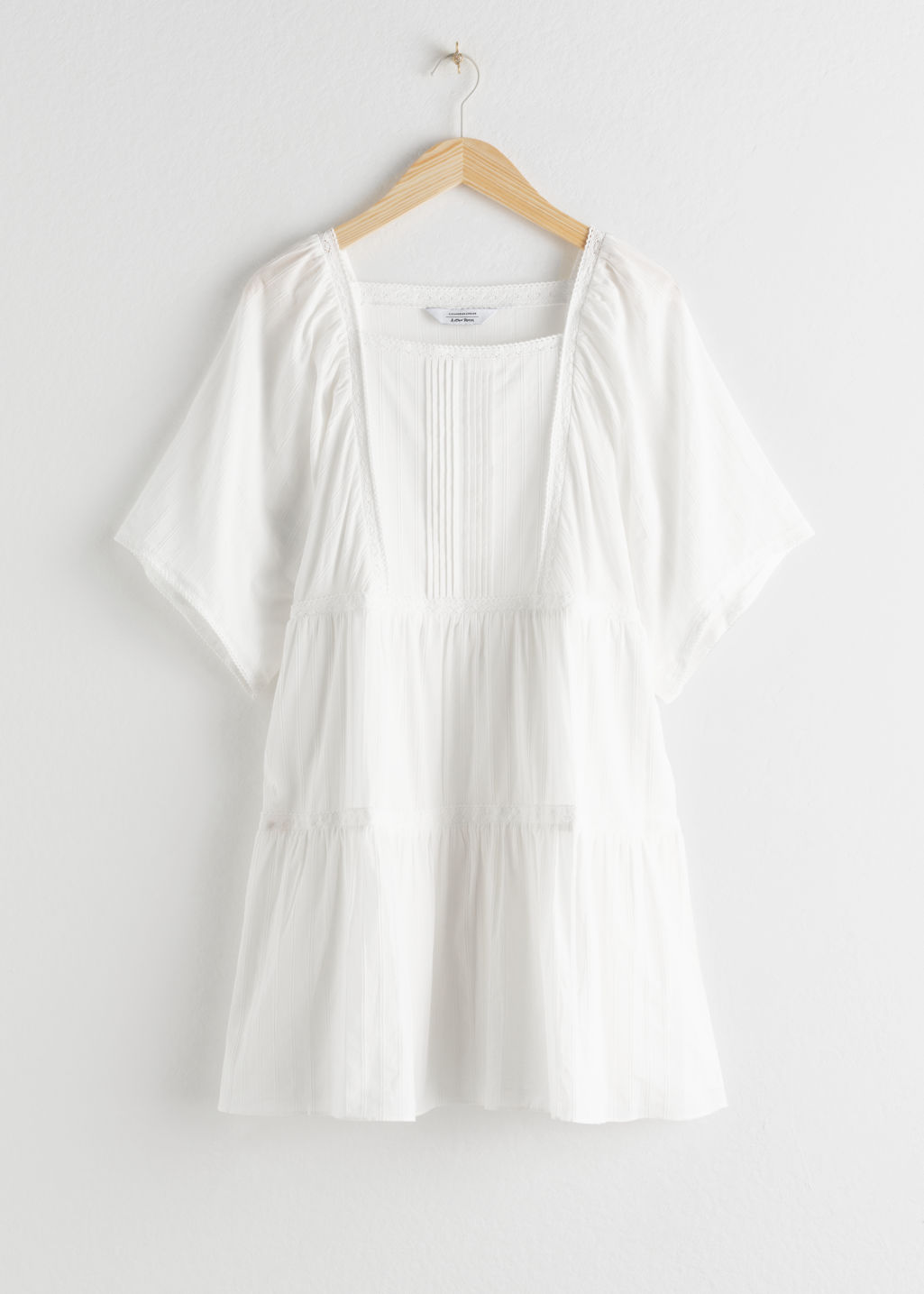 Front image of Stories tiered ruffled cotton mini dress in white