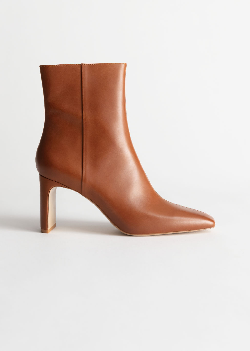 Front image of Stories square toe leather ankle boots in orange