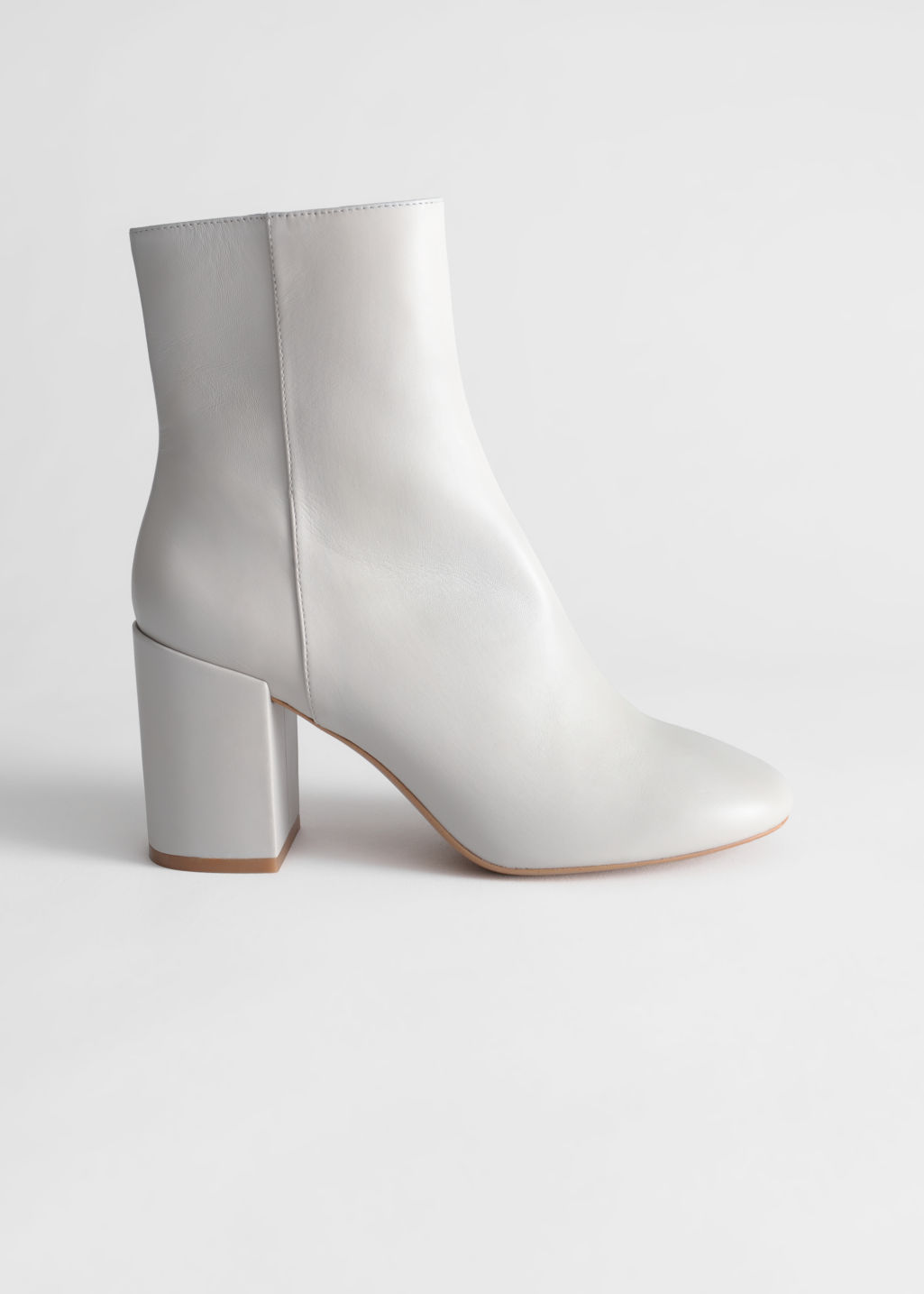 Front image of Stories block heel leather boots in grey
