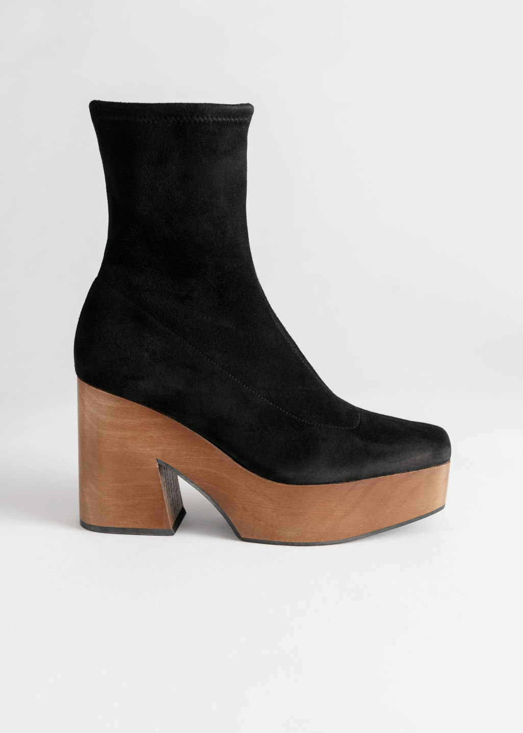 Front image of Stories suede wooden platform boots in black