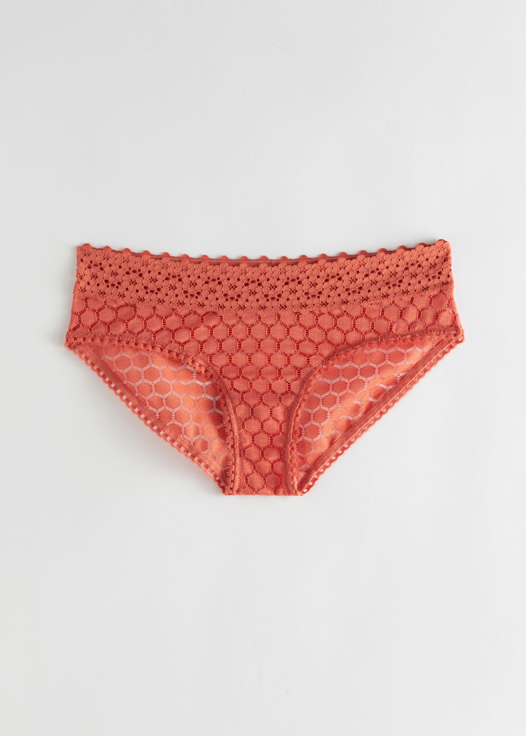 Front image of Stories honeycomb lace eyelet briefs in orange
