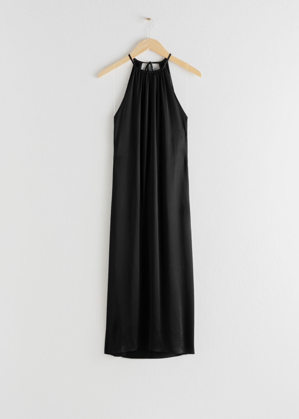 Front image of Stories gathered halter dress in black