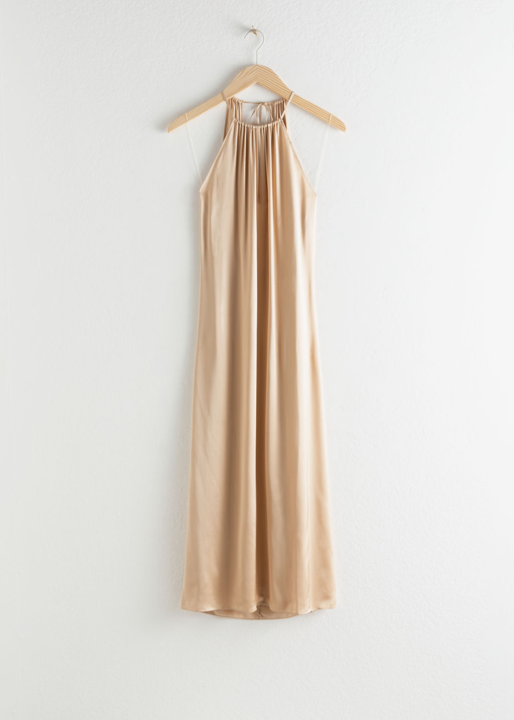 Front image of Stories gathered halter dress in beige