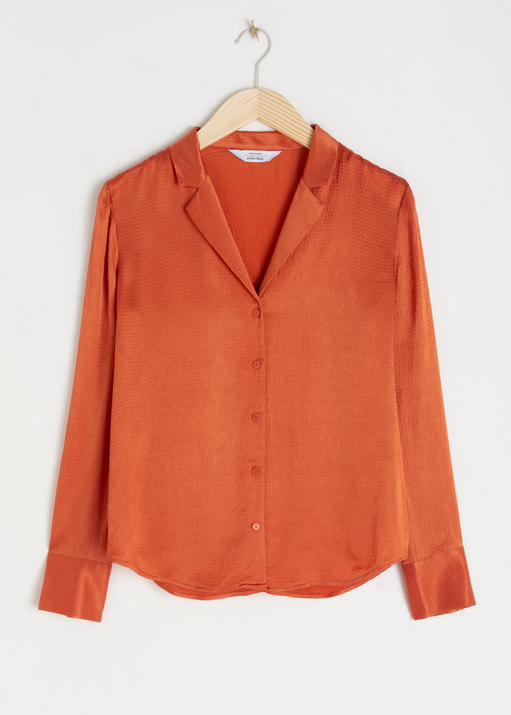 Front image of Stories button up satin blouse in orange