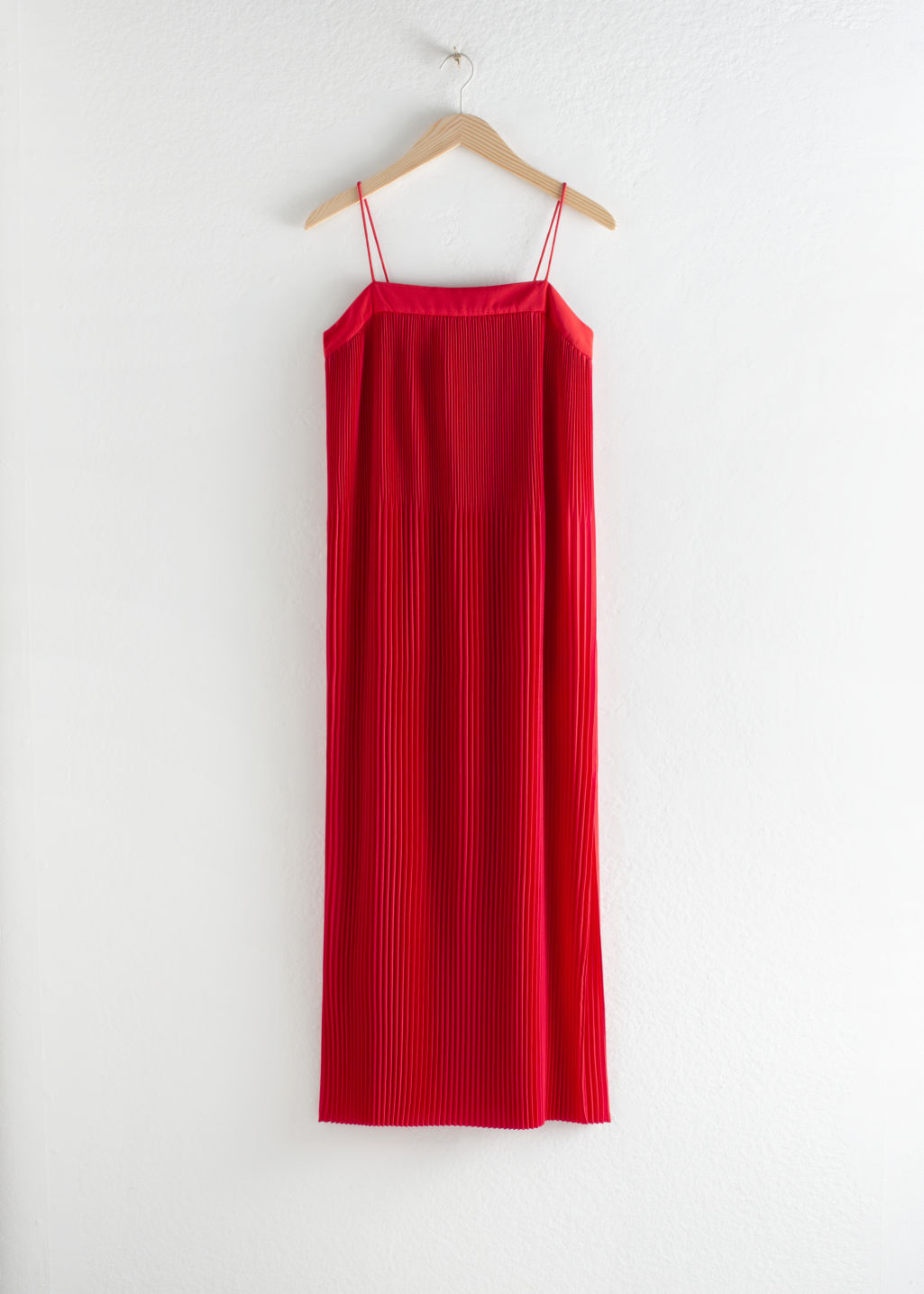 Front image of Stories plissé pleated midi dress in red