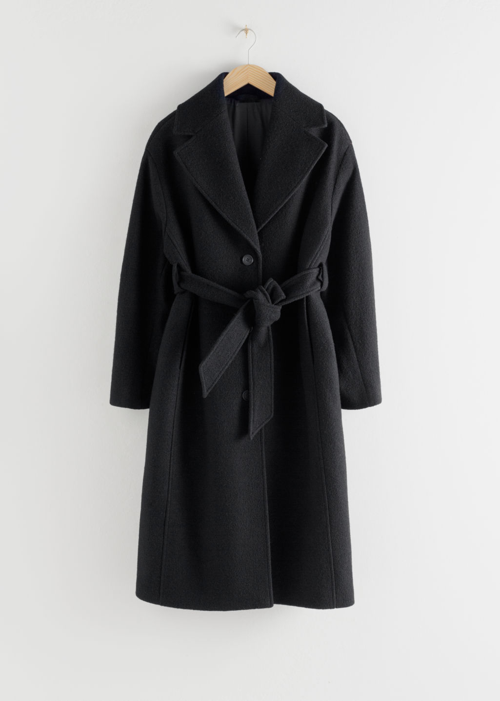 Front image of Stories oversized belted wool coat in black