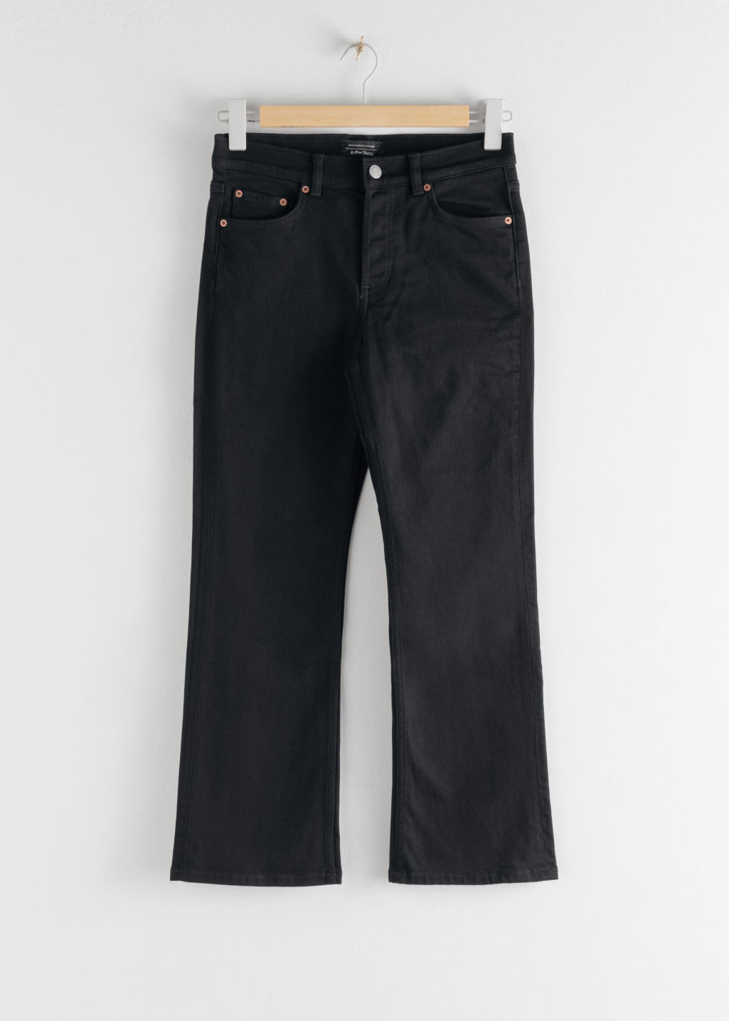 Front image of Stories classic kick flare mid rise jeans in black