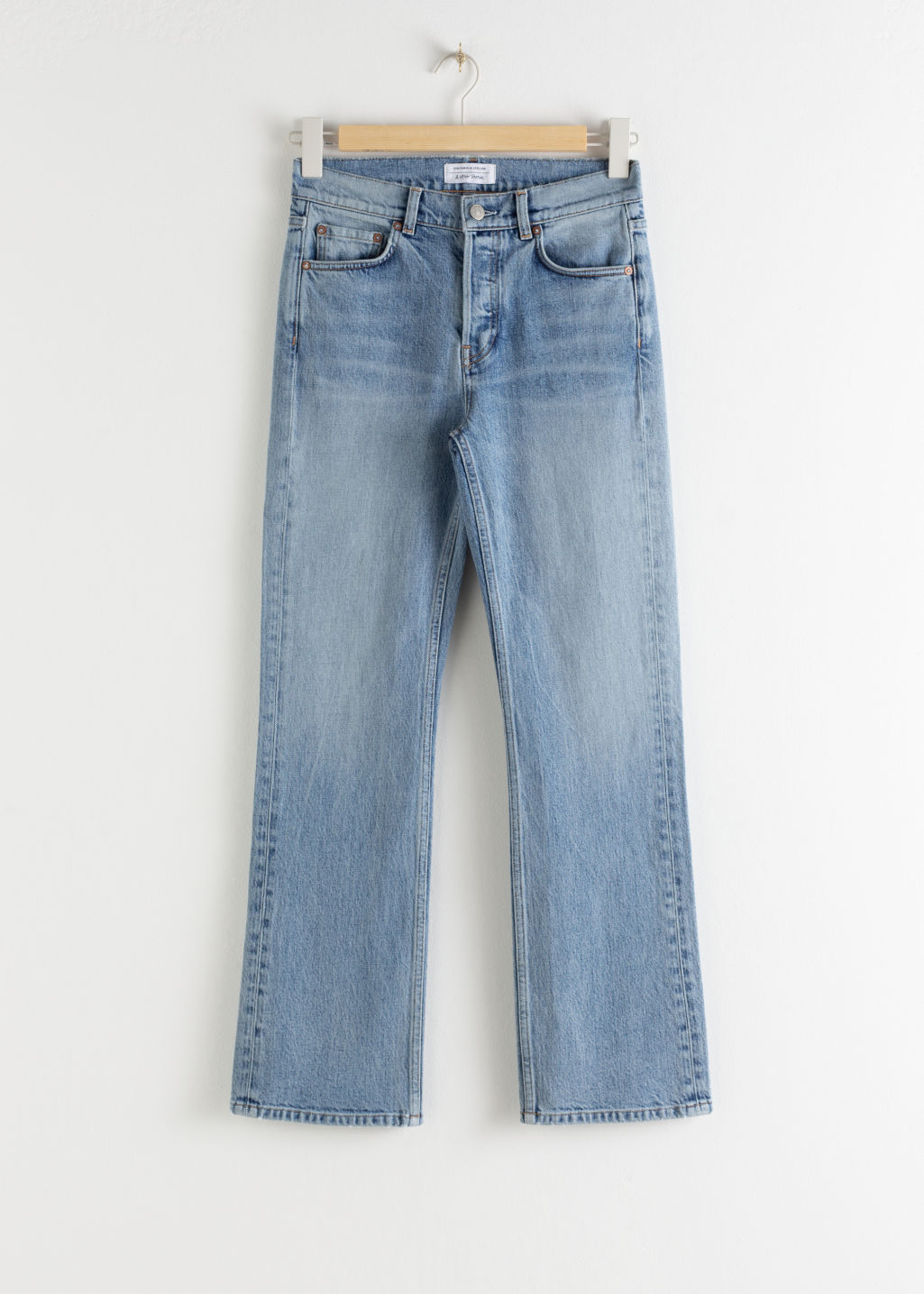 Front image of Stories classic kick flare mid rise jeans in blue