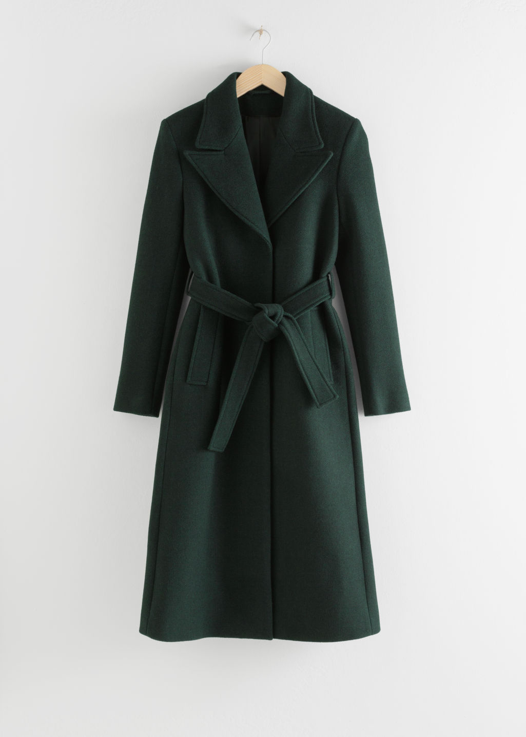 Front image of Stories belted wool blend long coat in green