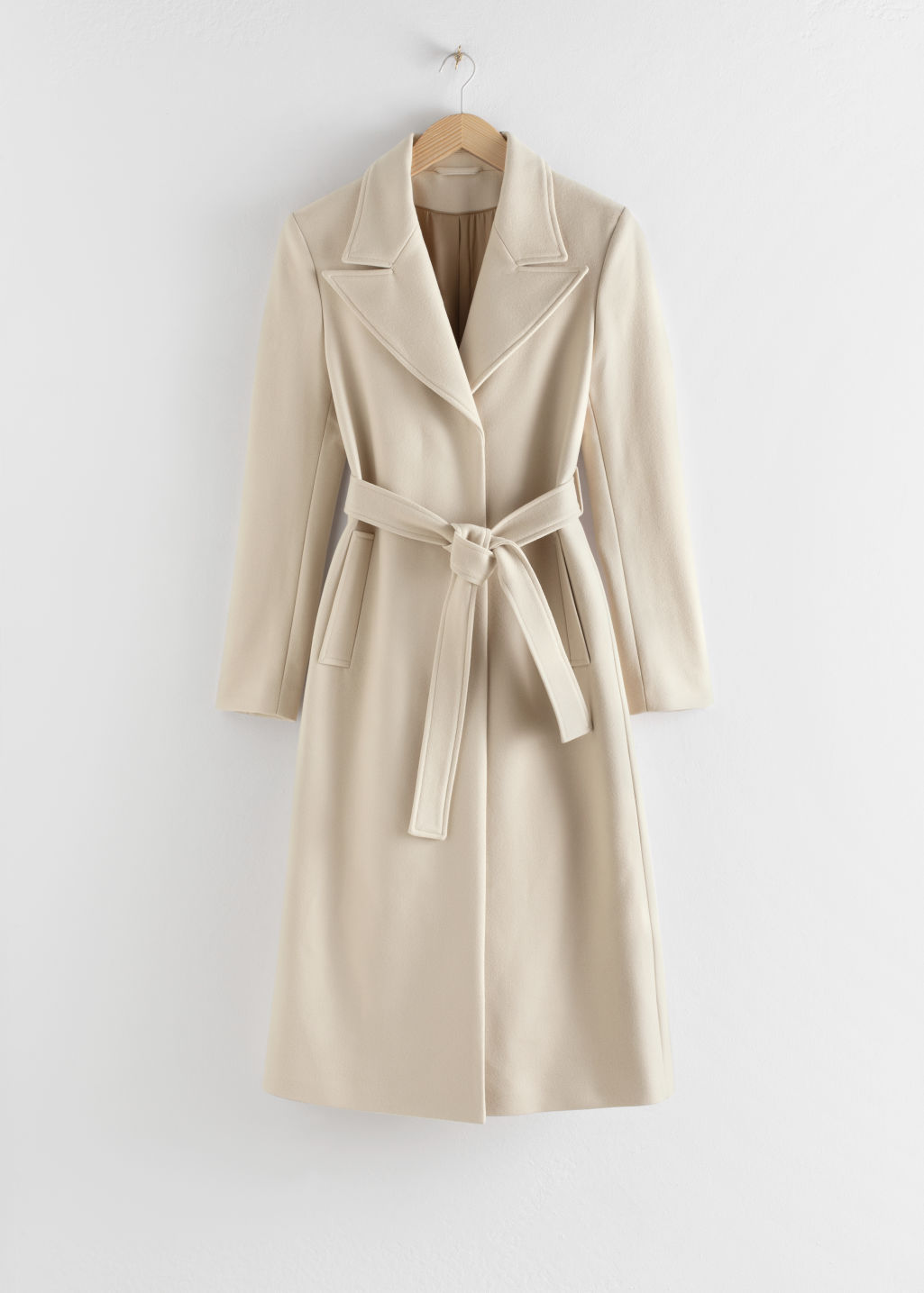 Front image of Stories belted wool blend long coat in beige