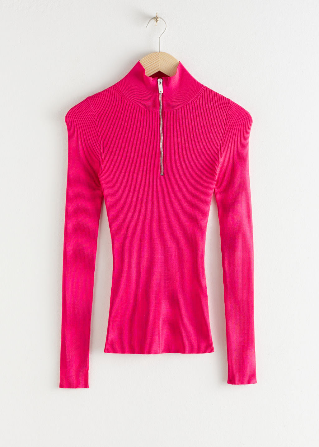 Front image of Stories half zip ribbed knit turtleneck in pink