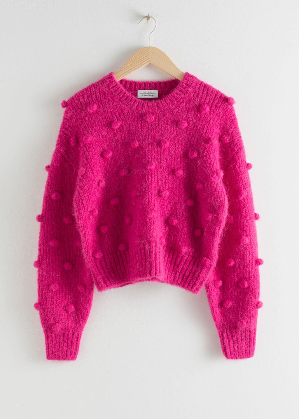 Front image of Stories alpaca wool knit bobble sweater in pink