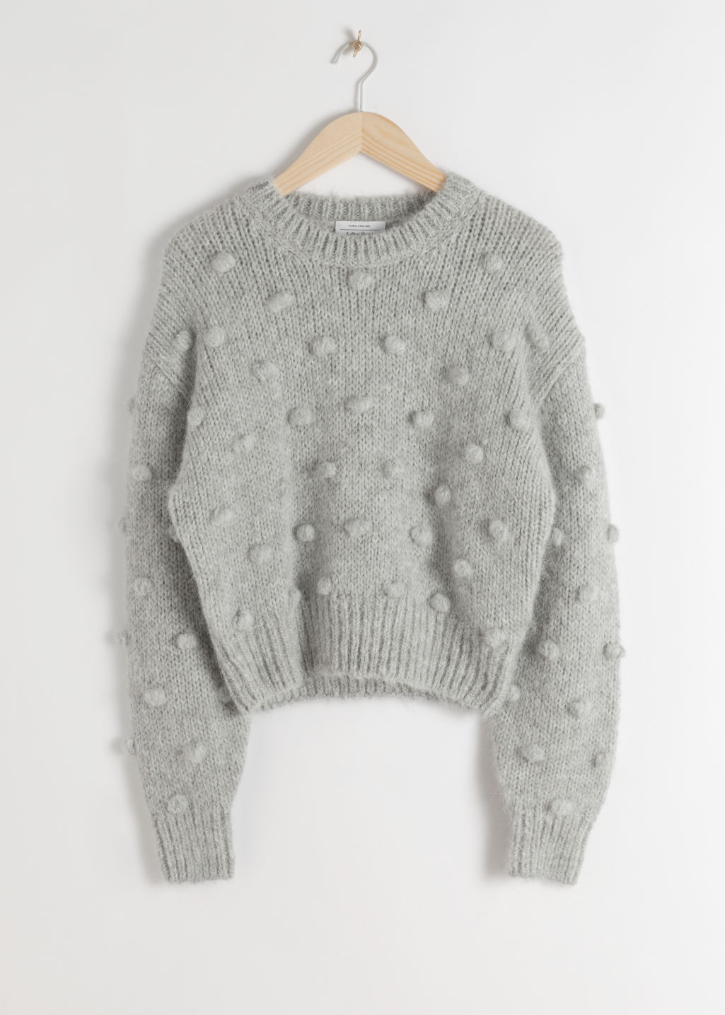 Front image of Stories alpaca wool knit bobble sweater in grey