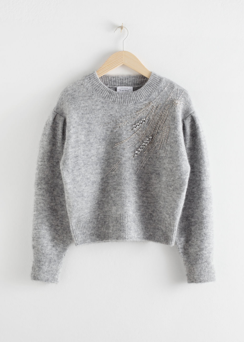 Front image of Stories embellished wool blend sweater in grey