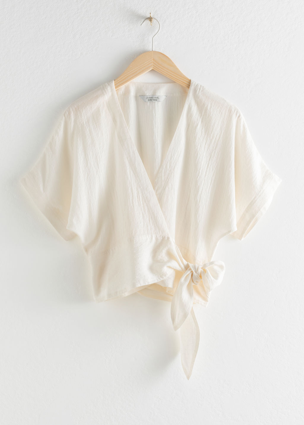Front image of Stories lyocell wrap top in white