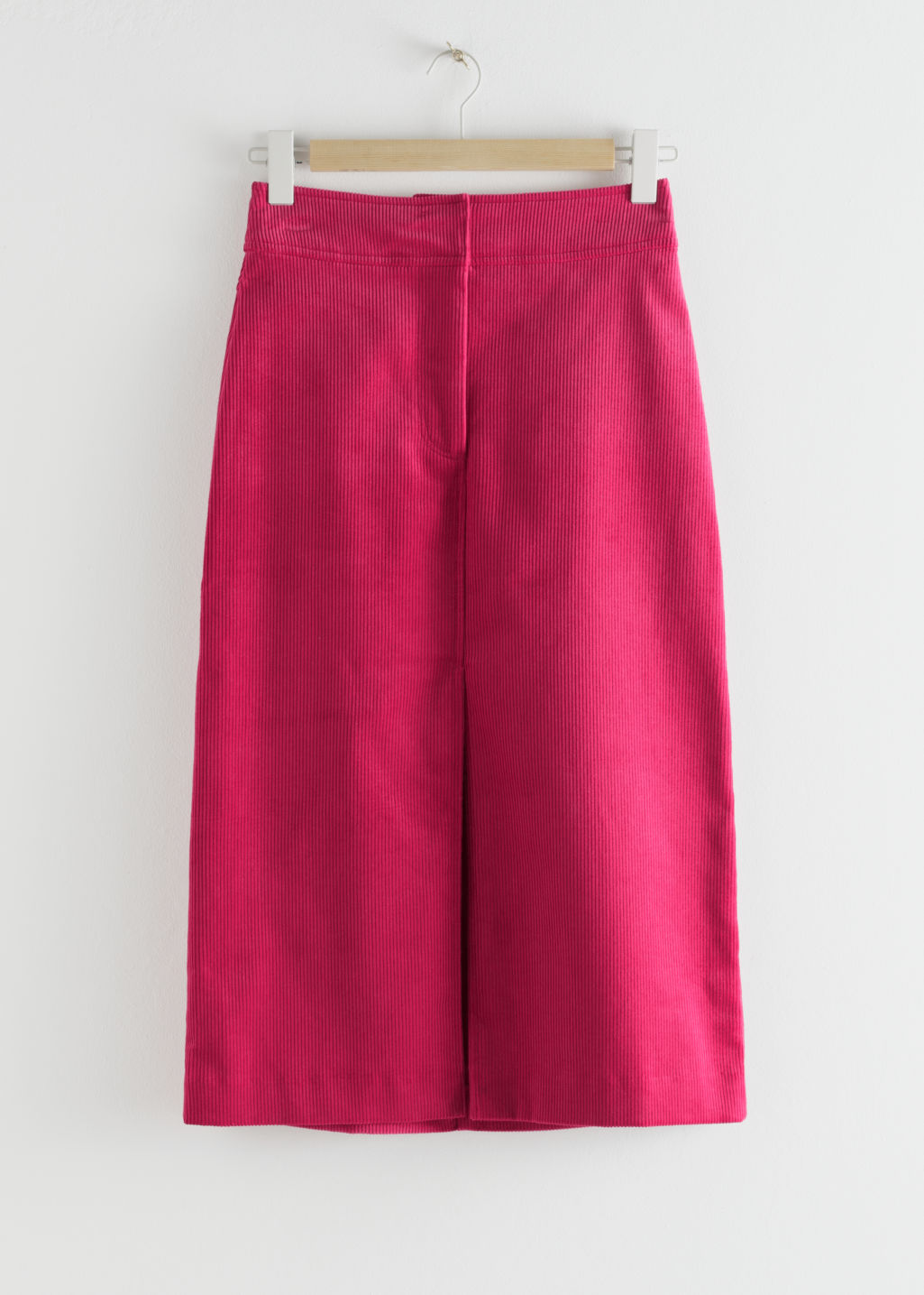 Front image of Stories corduroy front split midi skirt in pink