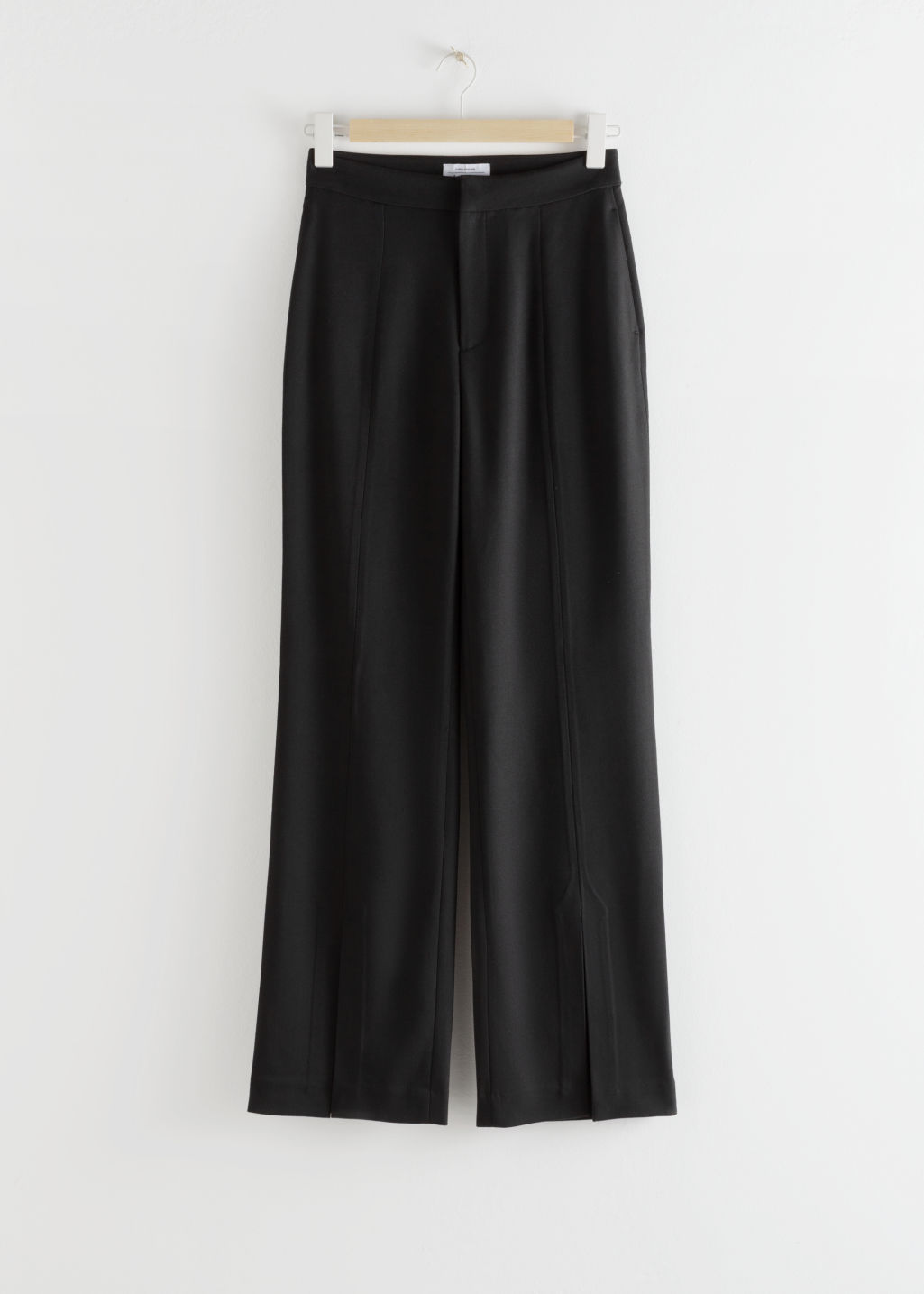 Front image of Stories front split tailored trousers in black