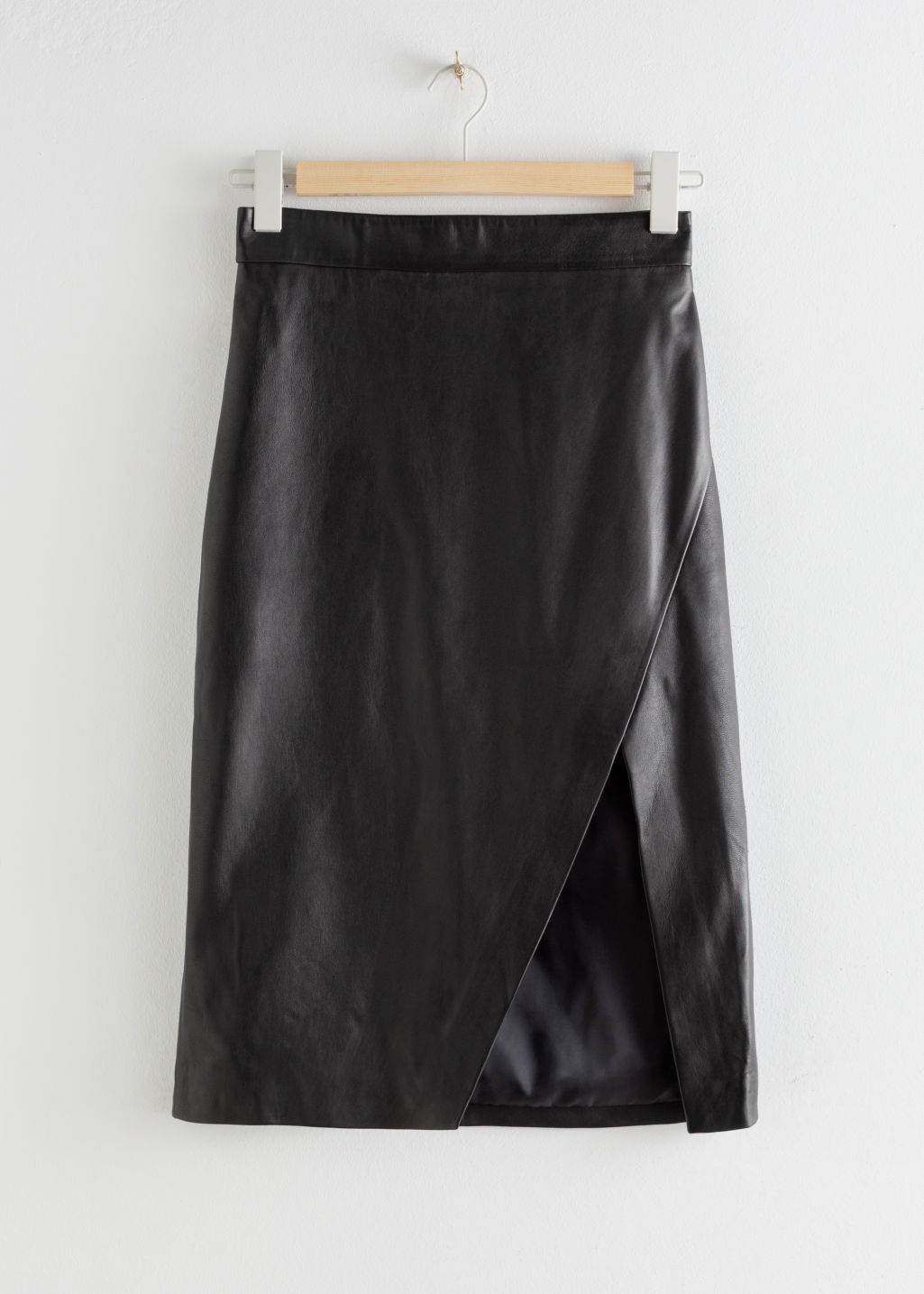 Front image of Stories leather asymmetric pencil skirt in black