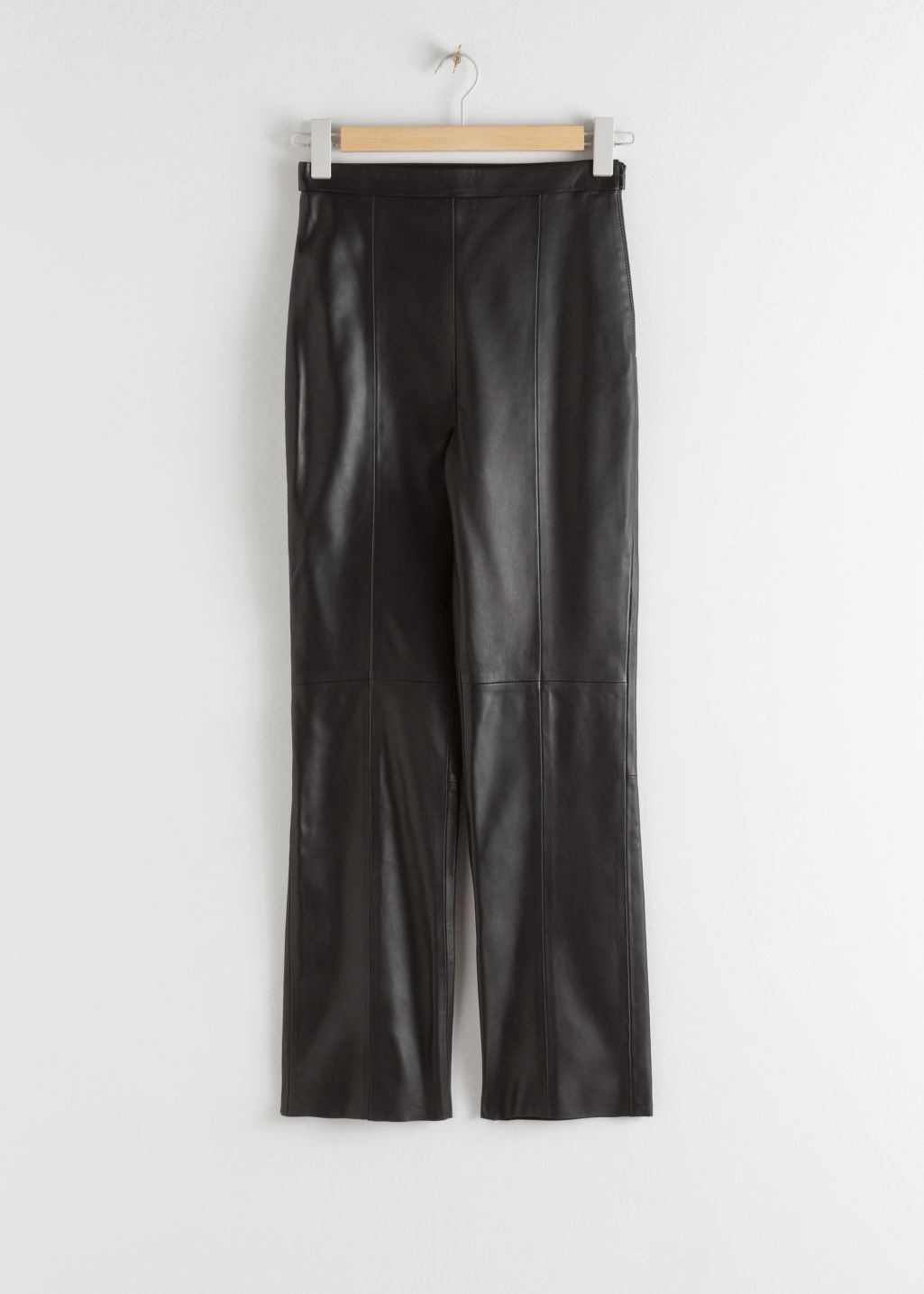 Front image of Stories soft leather trousers in black