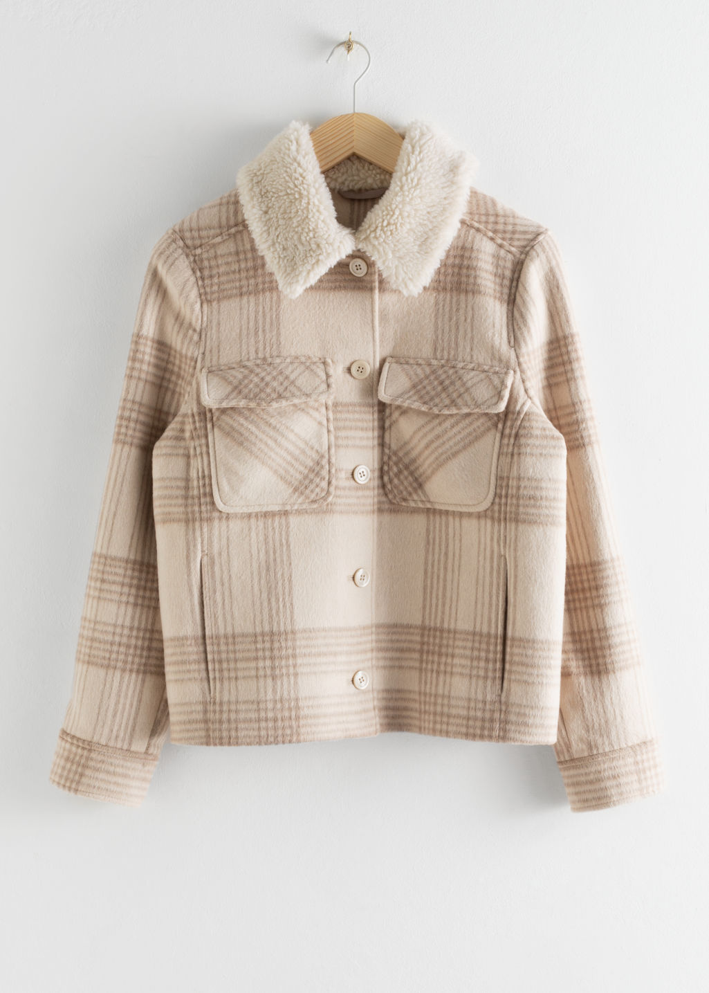 Front image of Stories faux shearling collar plaid coat in beige