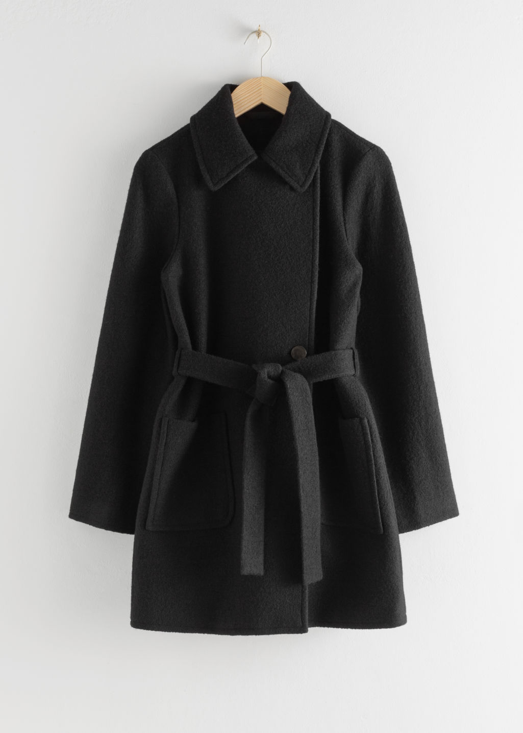 Front image of Stories belted houndstooth wool blend coat in black
