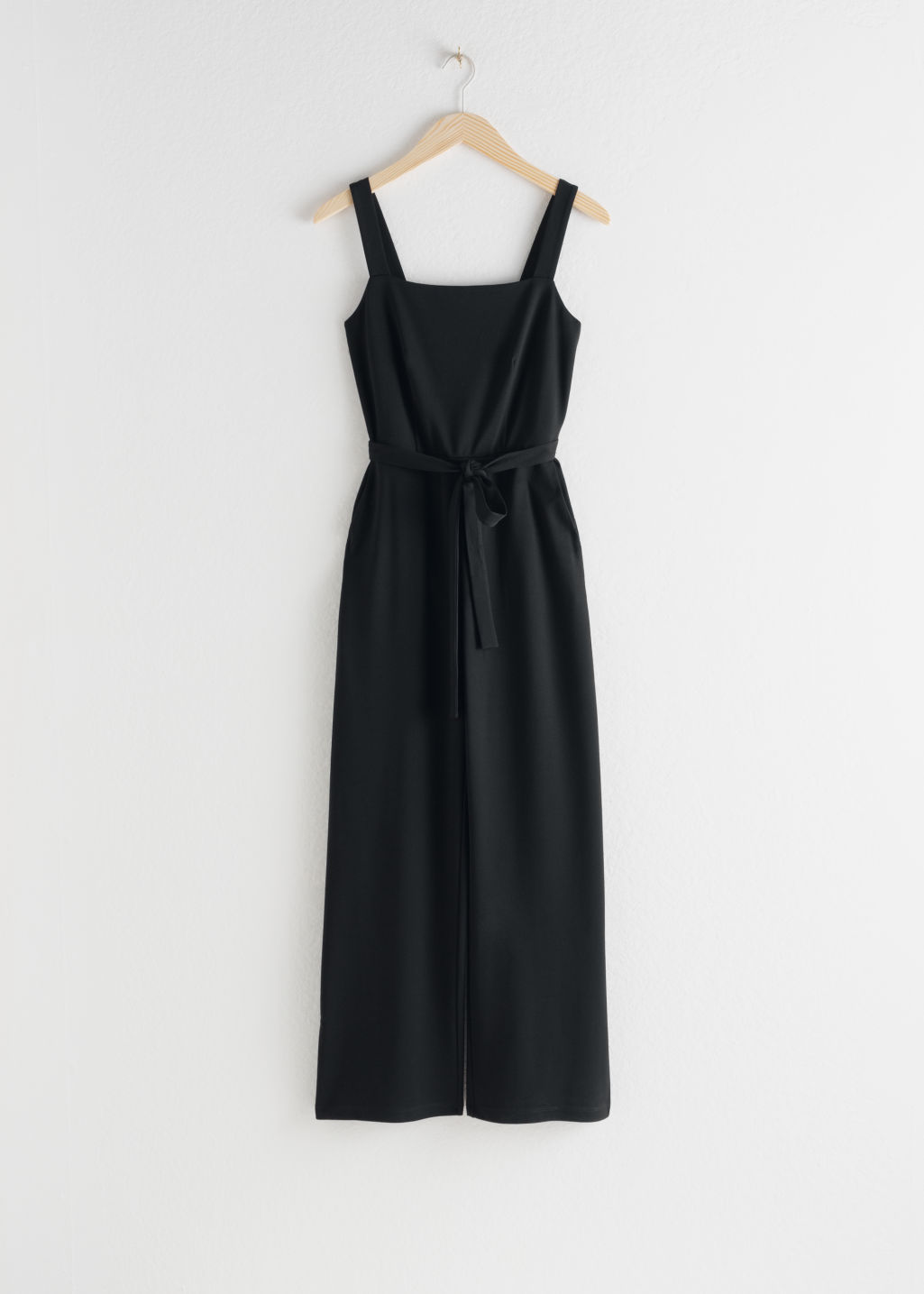Front image of Stories belted square neck jumpsuit in black
